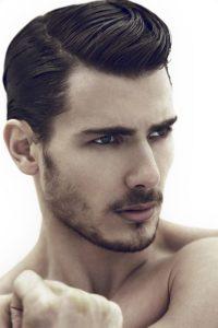peinado hombre a un lado años 50